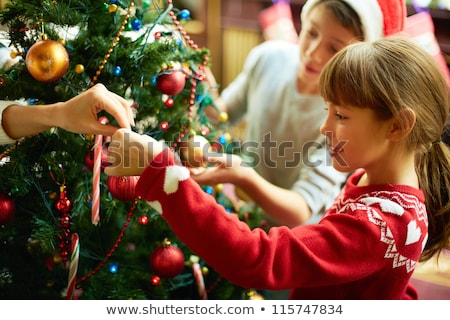 Girl in a red sweater on the background of new year decorations and snow stock photo © ElenaBatkova