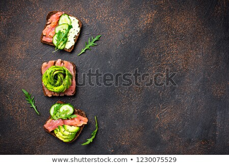 Healthy toasts with salmon and avocado rose Stock photo © furmanphoto
