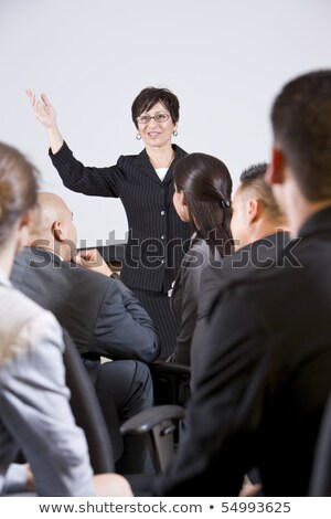 Front view of diverse group of business people listening to businessman speak at a business seminar  Stock photo © wavebreak_media