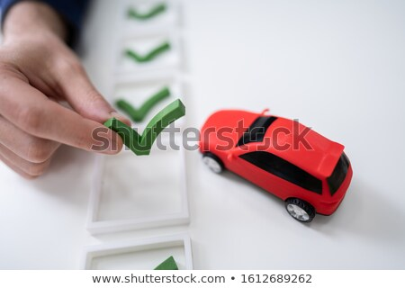 Human Hand Placing Check Mark Icon Puzzle Stock photo © AndreyPopov