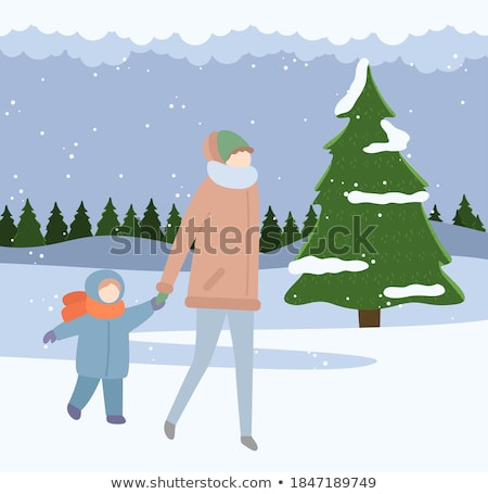 Girl in warm clothes in winter walking on snow-covered snowdrifts Stock photo © ElenaBatkova