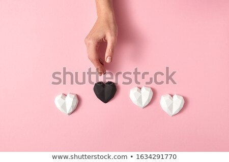 Holiday pattern from gypsum white hearts and one black. Stock photo © artjazz