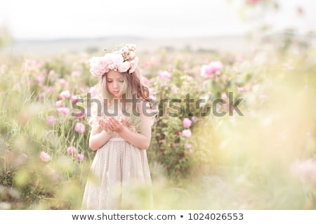 Girl on the floral field Stock photo © Anna_Om