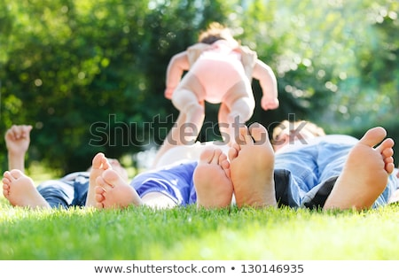 Parents and baby on grass Stock photo © Paha_L