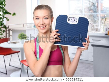 Woman holding house shaped measuring device Stock photo © photography33