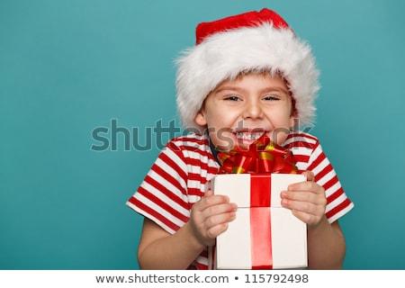 Young boy with christmas present Stock photo © photocreo