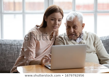 Man helping granddad with computer Stock photo © photography33