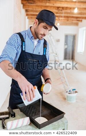 Decorator preparing paint roller stock photo © photography33