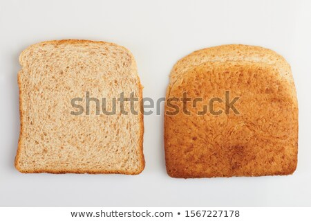 cut slices bread isolated on a white background stock photo © ozaiachin