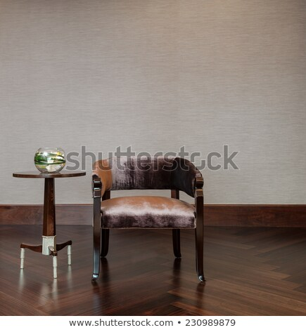 Chair and coffee table in a decorative setting Stock photo © 3523studio