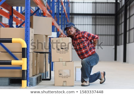 A handyman with his back hurting. Stock photo © photography33