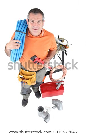 Plumber with a reel of copper pipe Stock photo © photography33