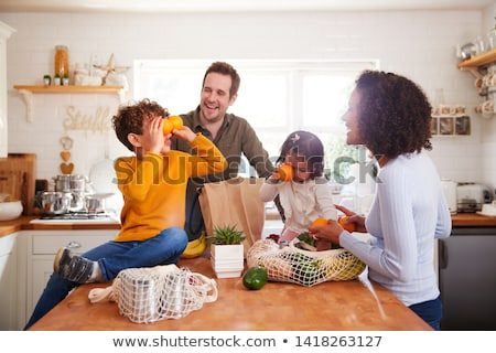 Happy woman returning from shopping trip Stock photo © photography33