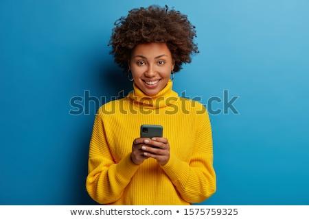 счастливым · женщину · розовый · телефон · портрет · лице - Сток-фото © dolgachov