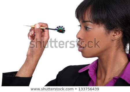 Black beauty playing darts Stock photo © stockyimages