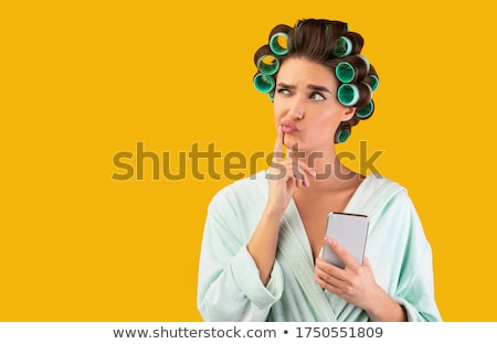 woman with hair curlers Stock photo © stepstock