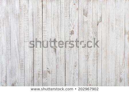 Weathered painted wood as background Stock photo © haraldmuc