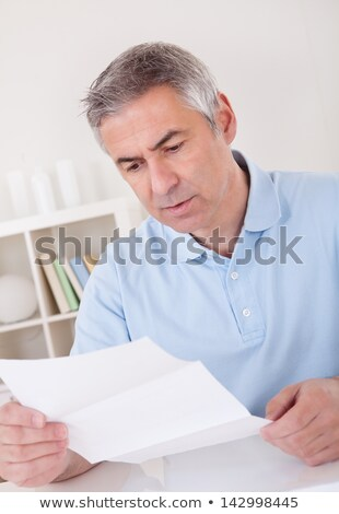 Horrified man reading a document Stock photo © AndreyPopov