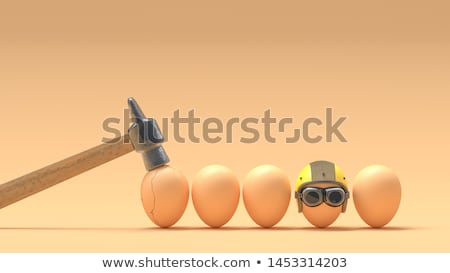 Egg cracking with hammer Stock photo © icefront