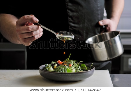 chef plating up food in a restaurant stock photo © juniart