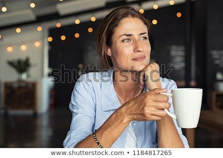 Rijpe vrouw denken hand kin witte gelukkig Stockfoto © wavebreak_media