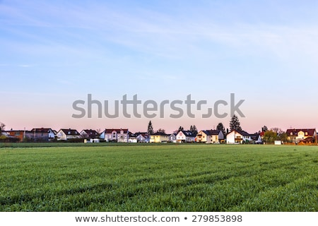 rural landscape in munich with new settlement and fields stock photo © meinzahn