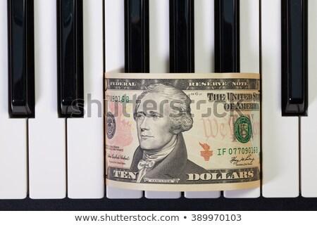 Zongora billentyűzet dollár bankjegy részlet zene Stock fotó © CaptureLight