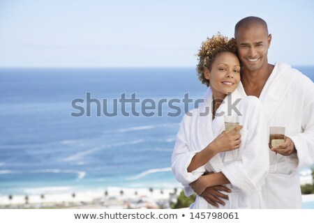 Portrait of smiling couple embracing and holding wineglass Stock photo © wavebreak_media
