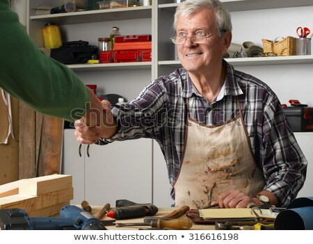 man at work on a retail carpenters desk stock photo © ozgur
