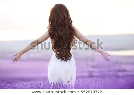 free brunette woman with open arms enjoying sunset in lavender f stock photo © victoria_andreas