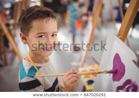 schoolboy panting on canvas Stock photo © wavebreak_media
