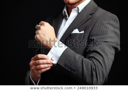 Férfi megjavít mandzsettagombok öltöny mosolyog kamerába Stock fotó © filipw