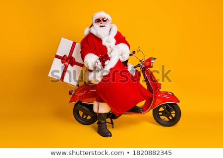 Santa Claus putting presents in christmas bag stock photo © wavebreak_media