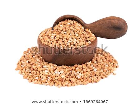 bowl of green buckwheat porridge and spoon isolated healthy foo stock photo © maryvalery