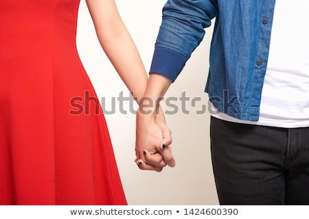 Közelkép házas leszbikus pár kéz a kézben emberek Stock fotó © dolgachov