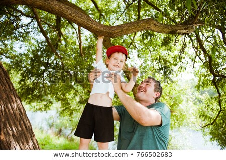 man helping son to climb tree Stock photo © IS2