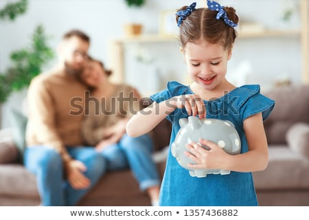 couple holding piggy banks Stock photo © IS2