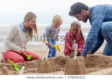 Mère enfant bâtiment sandcastle famille amour Photo stock © IS2
