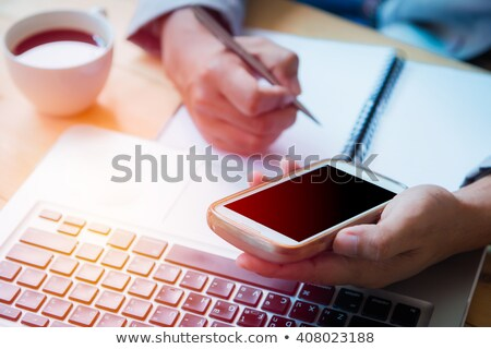 Businessman and woman on lap-top Stock photo © IS2