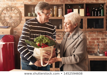 couple in kitchen carrying recycling stock photo © is2