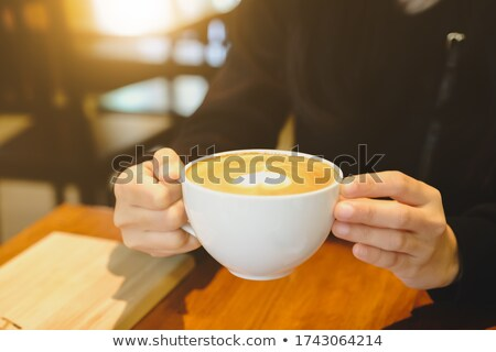 contemplated happy businesswoman with cup of coffee stock photo © andreypopov