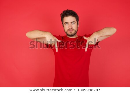Caucasian man in striped t-shirt gesturing and demonstrating siz Stock photo © deandrobot