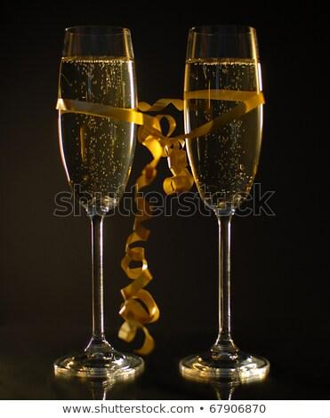 Pezsgő szemüveg pezsgő arany fekete bokeh Stock fotó © MarySan