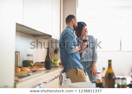male alcoholic drinking wine from bottle at home Stock photo © dolgachov