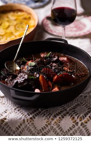 Carne bochechas vinho tinto cenouras batata vinho Foto stock © zoryanchik
