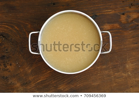 Bone broth made from chicken on a wooden table Stock photo © madeleine_steinbach