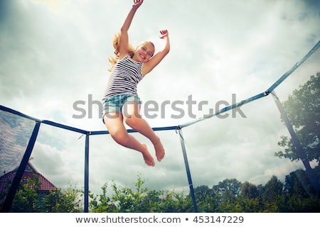 Children jumping on trampoline Stock photo © colematt