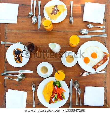 Continental breakfast with pancakes, eggs, bacon, orange jiuce a Stock photo © dashapetrenko