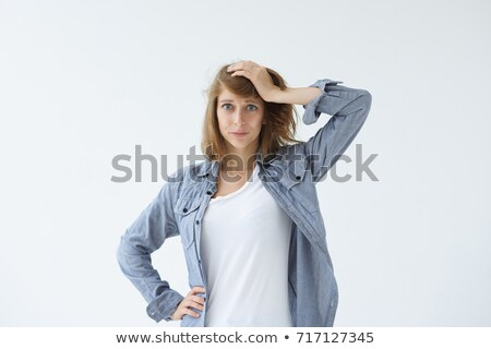 Triste paura donna posa isolato grigio Foto d'archivio © deandrobot
