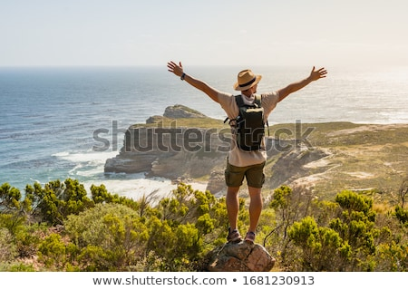 summer relaxation and good time people by seaside stock photo © robuart